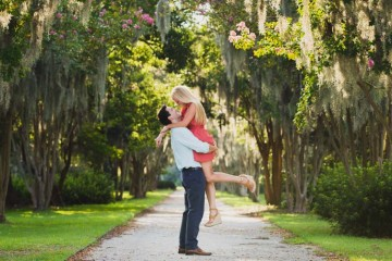 engagement pictures taken in charleston sc garden by charleston wedding photographers king street studios