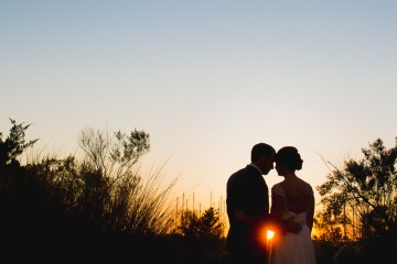 beautiful wedding portraits taken at sunset by charleston wedding photographers king street studios
