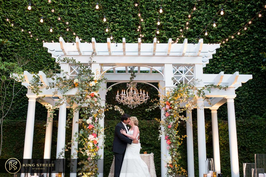 charleston wedding photography kissing at the william aiken house by charleston wedding photographers king street studios